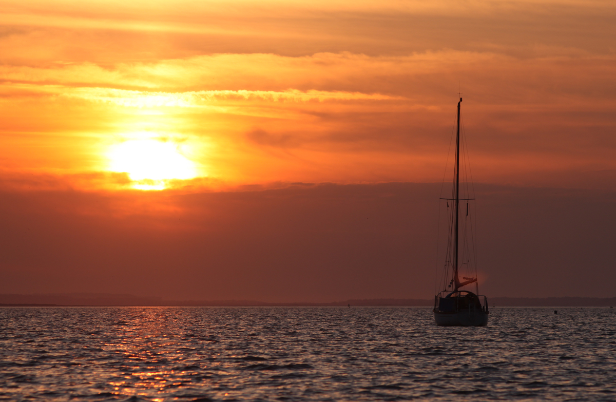 Sail boat in the sunset at Blakeney